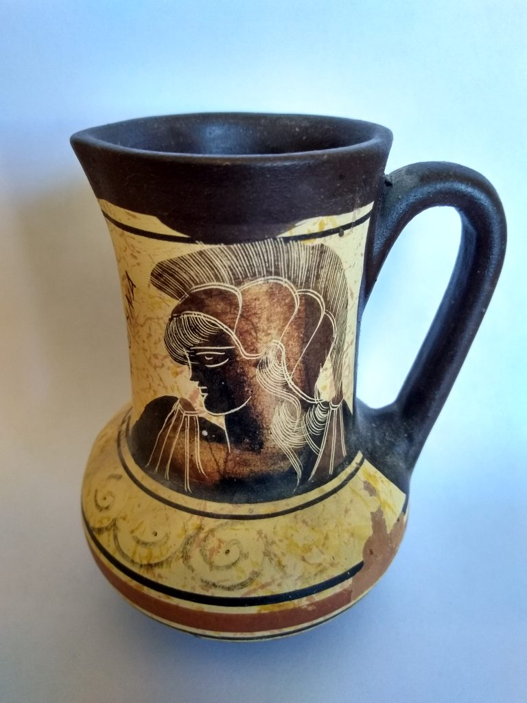 A reproduction of an ancient pitcher depicting Athena.