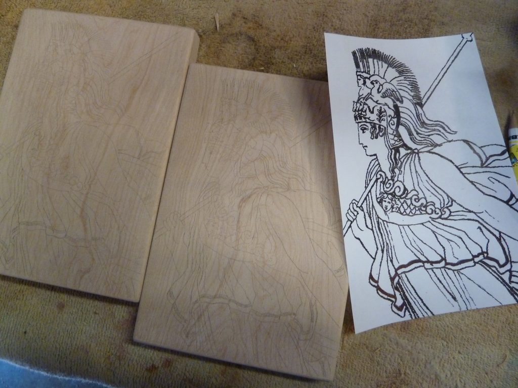 The image of Athena on paper, and the same image sketched onto both pieces of wood.
