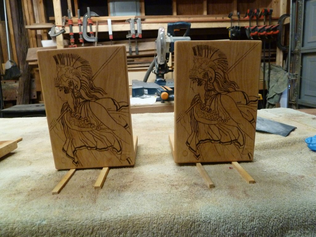 Both bookends in the process of securing the fronts to the bases.
