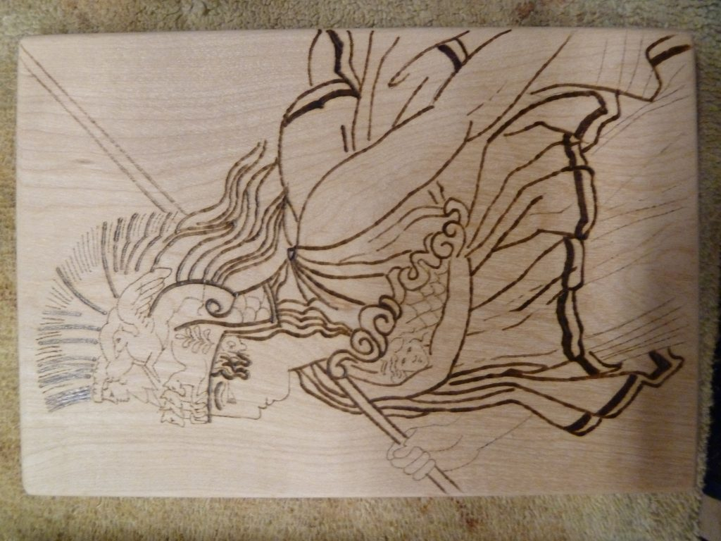 A closer view of one of the woodburned images of Athena.